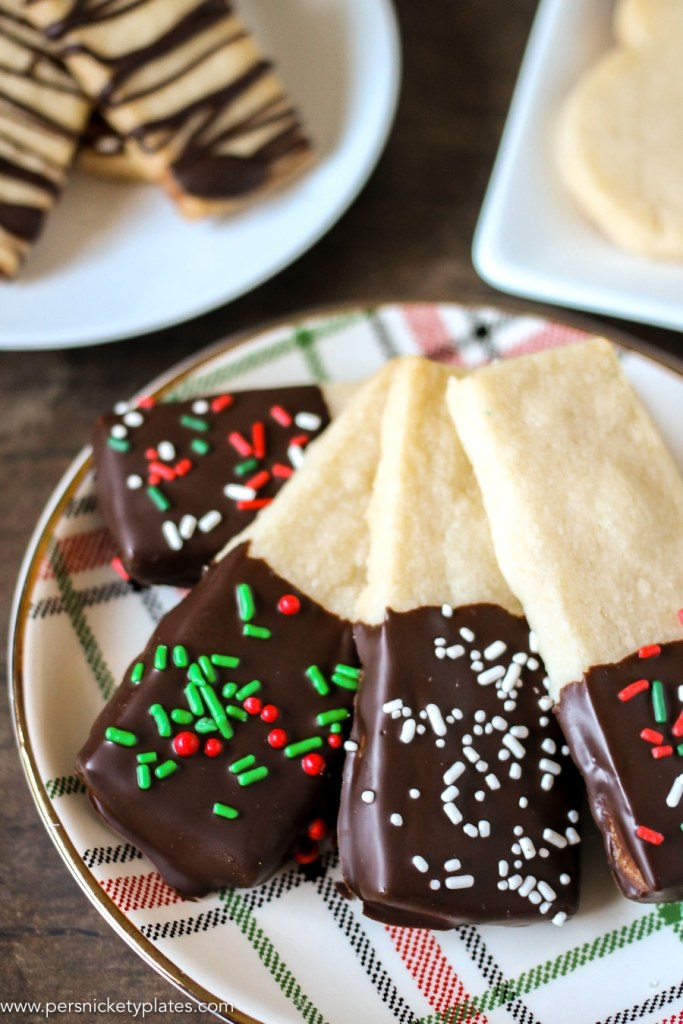 Chocolate Dipped Shortbread Cookies are a simple, from-scratch, shortbread cookie dipped in dark chocolate that's perfect for dunking in milk, coffee, hot chocolate...Santa won't be disappointed!