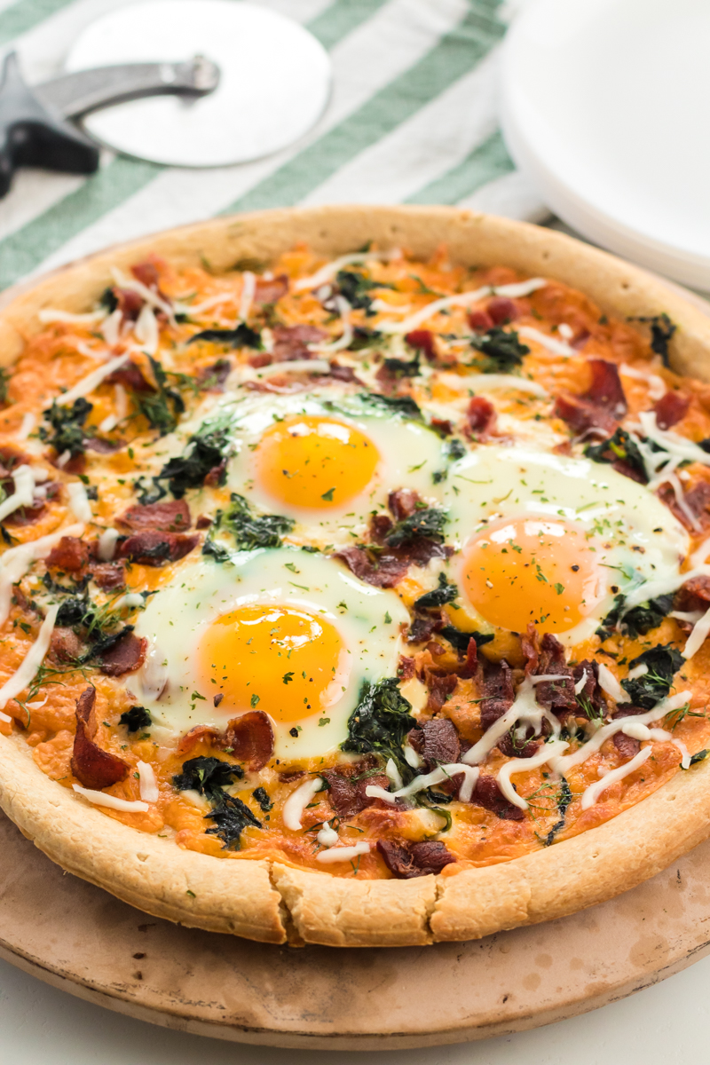 breakfast pizza topped with cooked eggs