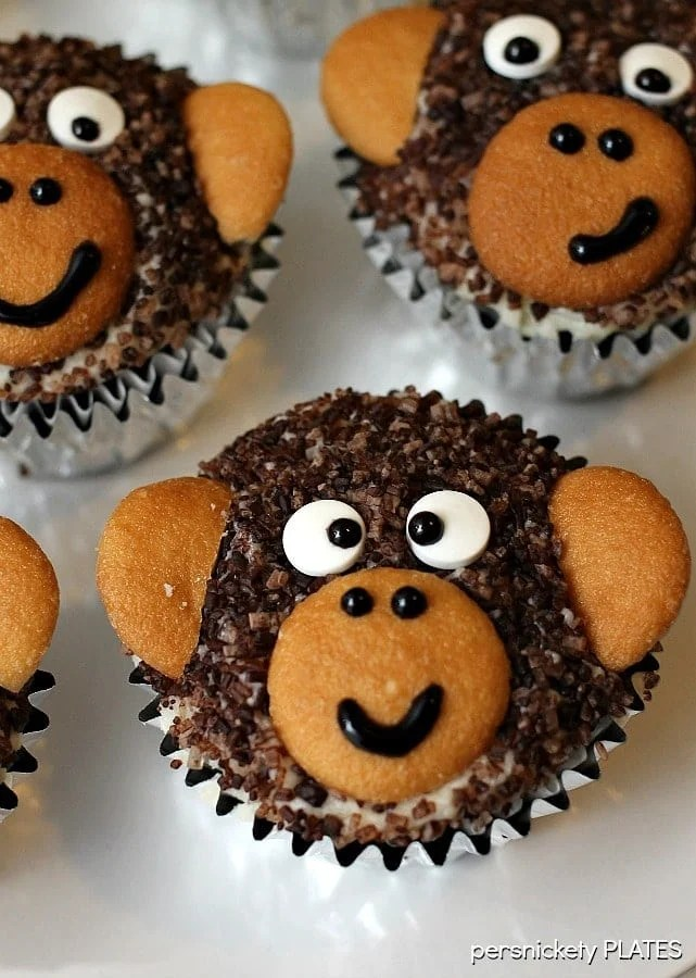 Monkey Cupcakes are such a cute dessert idea, you may not want to eat them! These delicious homemade chocolate cupcakes are made with chocolate sanding sugar and vanilla wafer ears! Perfect for a monkey themed birthday party!