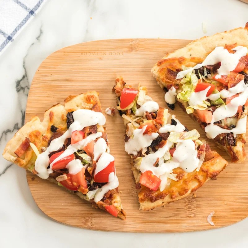 This BLT Pizza is semi-homemade and topped with cheese, bacon, lettuce, and tomatoes then drizzled with ranch dressing - a super easy meal for pizza night at home! | www.persnicketyplates.com