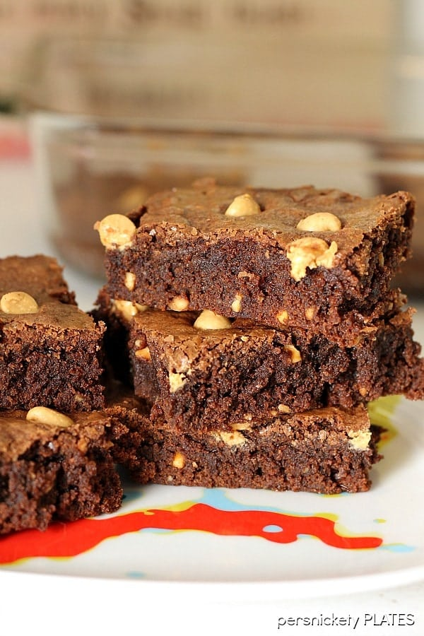 Peanut Butter Brownies are a simple, from scratch, brownie filled with chunky peanut butter and topped with peanut butter chips. Perfect for the chocolate + peanut butter lover in your life! | Persnickety Plates