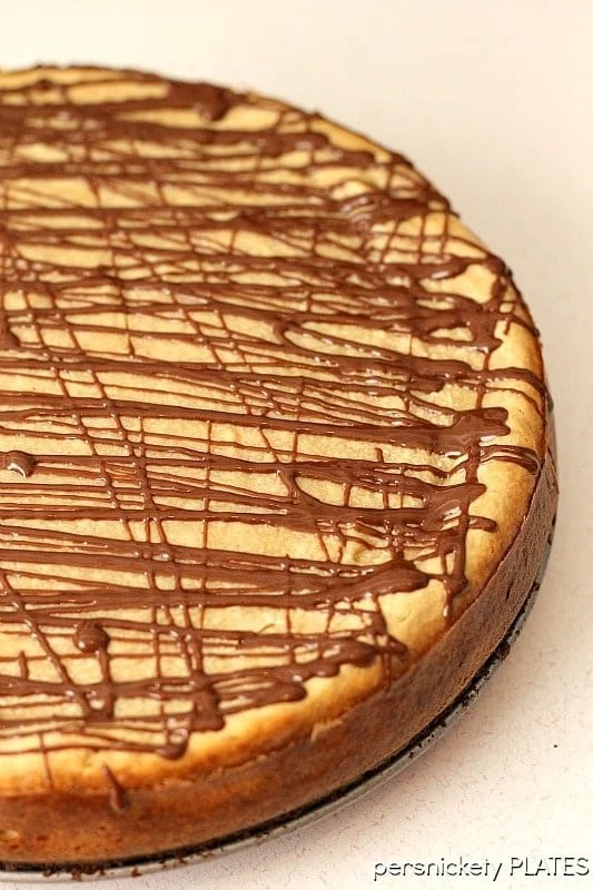 Brownie Bottom Peanut Butter Cheesecake has a layer of chewy brownie topped with a creamy peanut butter cheesecake and drizzled with rich chocolate.