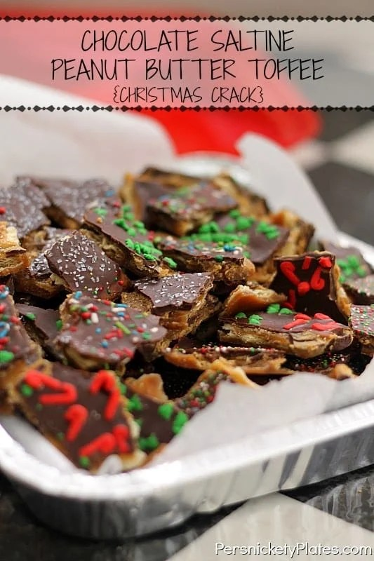 """This Chocolate Saltine Peanut Butter Toffee is so easy to make and so addictive, you'll quickly see why it's called """"Christmas Crack"""".   www.persnicketyplates.com"""