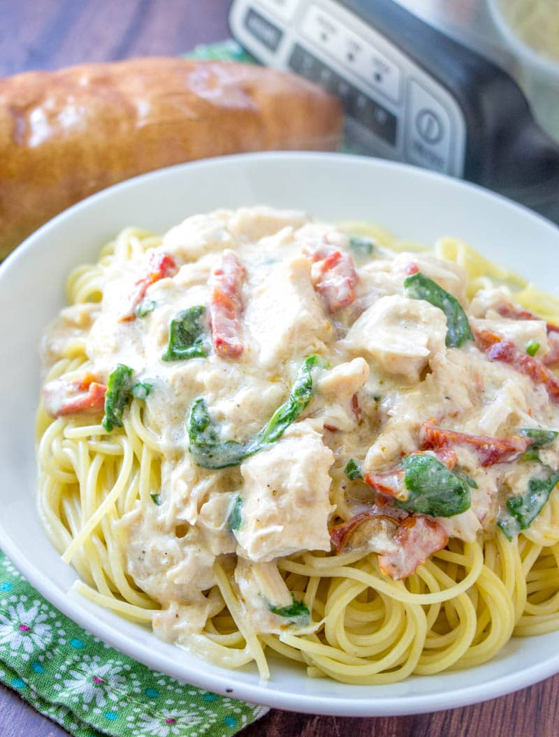 white bowl filled with crock pot chicken alfredo