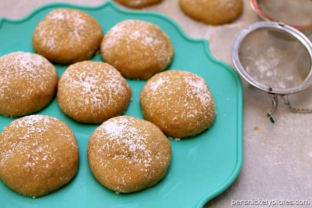 Brown Sugar Surprise Cookies - a simple, buttery, brown sugar cookie filled with a chocolate surprise! | www.persnicketyplates.com