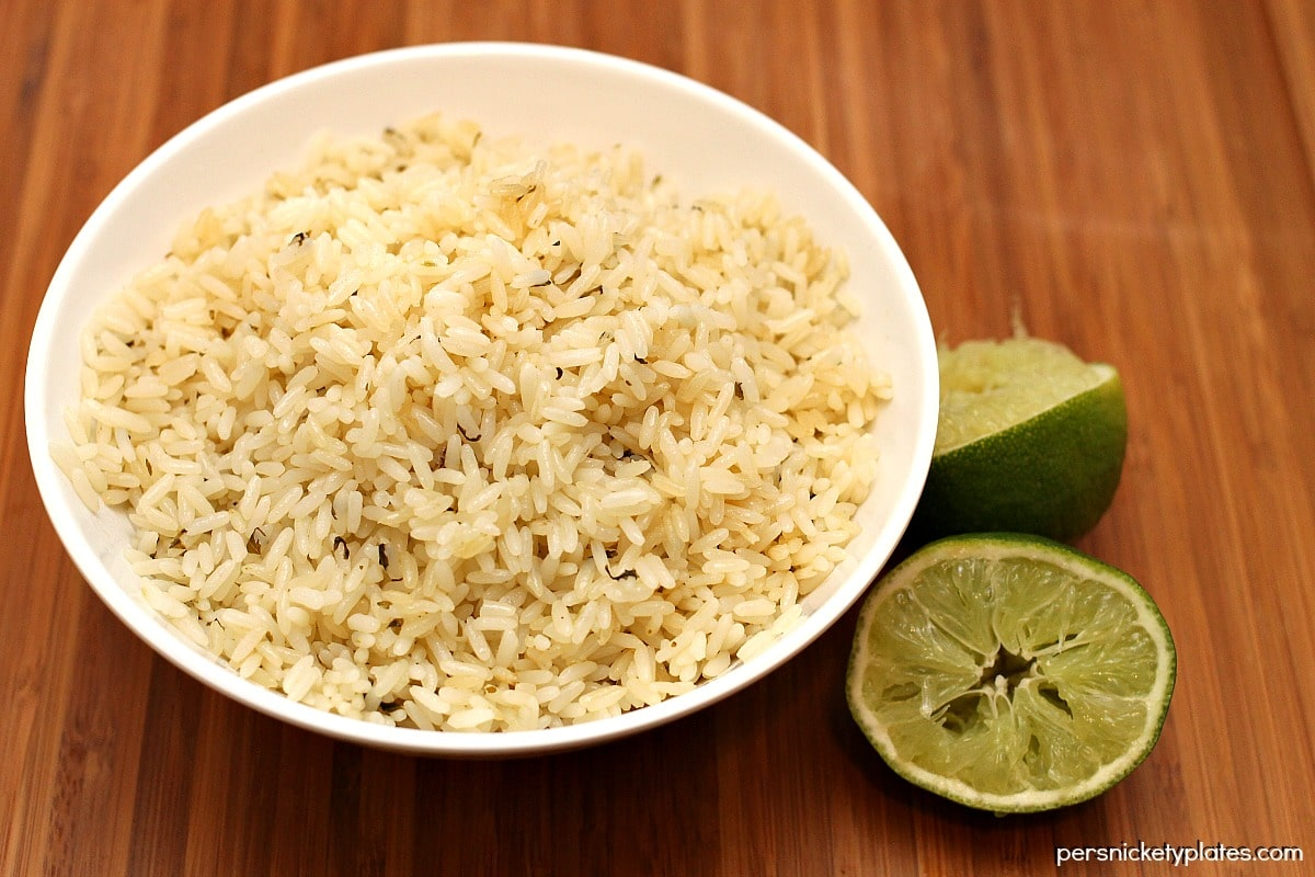 Making cilantro lime rice at home is nearly as easy as ordering it at your favorite Mexican restaurant! | Persnickety Plates