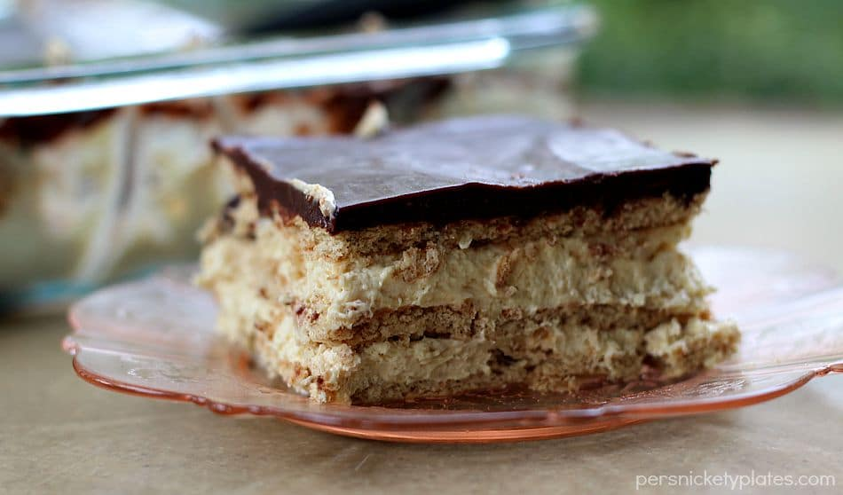 slice of layered chocolate eclair dessert on pink plate