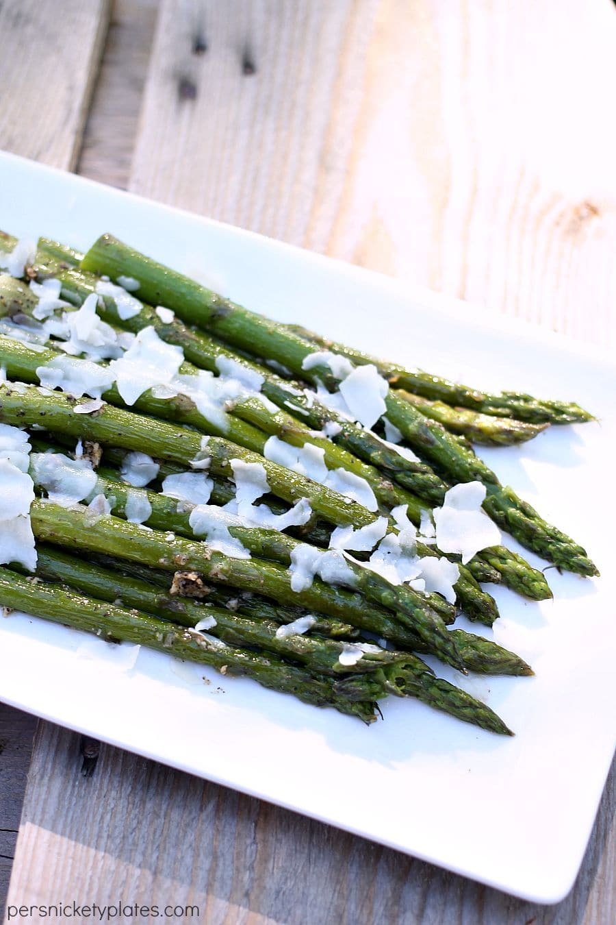 Sauteed Asparagus is a deliciously easy side dish that goes from stove to table in less than 15 minutes. Made with 6 ingredients, this is the best sauteed asparagus recipe that is packed full of flavor and perfect for any dinner plate. | www.persnicketyplates.com