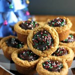 These semi-homemade Peanut Butter Cookie Cups filled with chocolate and topped with sprinkles are a definite crowd-pleaser and are perfect as a last minute holiday dessert addition.   Persnickety Plates AD