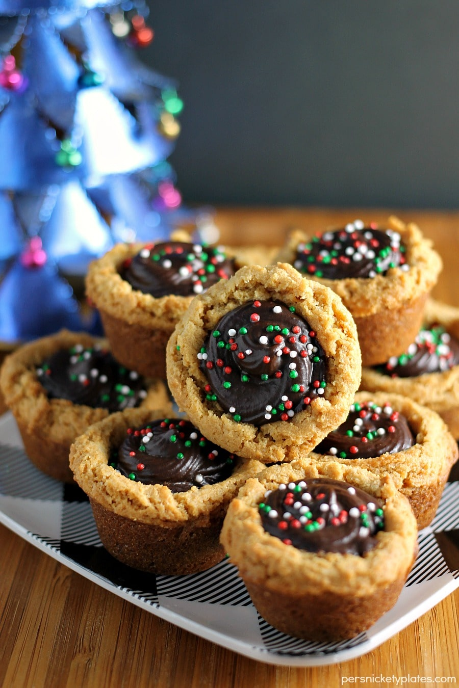 These semi-homemade Peanut Butter Cookie Cups filled with chocolate and topped with sprinkles are a definite crowd-pleaser and are perfect as a last minute holiday dessert addition. | Persnickety Plates AD