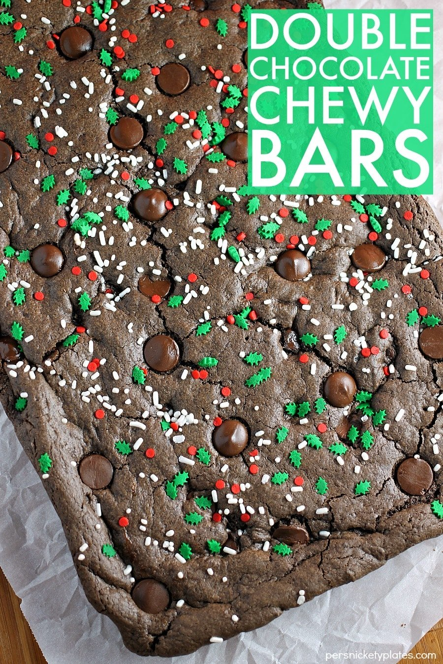 Double Chocolate Chewy Bars are semi-homemade and really simple - they start with a cake mix base and are dressed up with holiday sprinkles. Only five ingredients! | www.persnicketyplates.com
