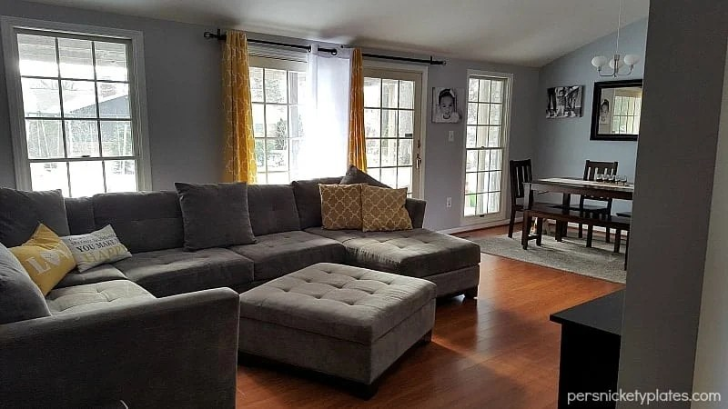 Before and after pictures of our living room/dining room done on a budget. Changing paint makes a huge difference - with Benjamin Moore Stonington Gray & Timber Wolf   Persnickety Plates