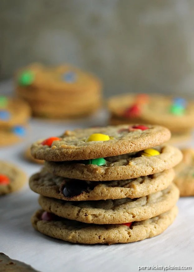 This Brown Sugar M&M Cookie recipe is a fun twist on the traditional sugar cookie that will definitely satisfy your sweet tooth. Crisp on the edges, chewy in the middle - just like a cookie should be! | www.persnicketyplates.com