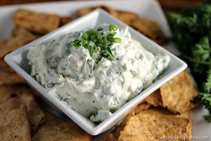 Garlic Herb Dip has a cream cheese base filled with fresh herbs. Super easy and paired with Van's Foods Crackers makes the perfect snack for your next party.   Persnickety Plates
