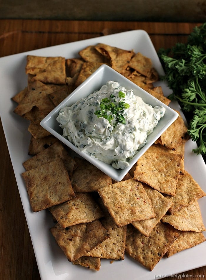 Garlic Herb Dip has a cream cheese base filled with fresh herbs. Super easy and paired with Van's Foods Crackers makes the perfect snack for your next party. | Persnickety Plates