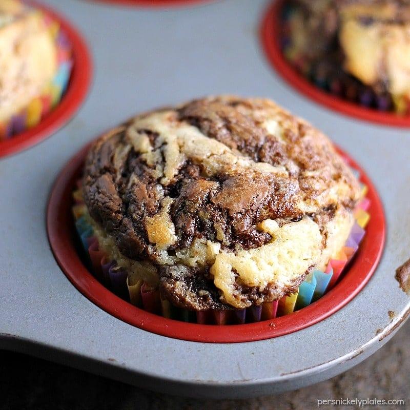 close up of nutella swirl muffin in muffin tin
