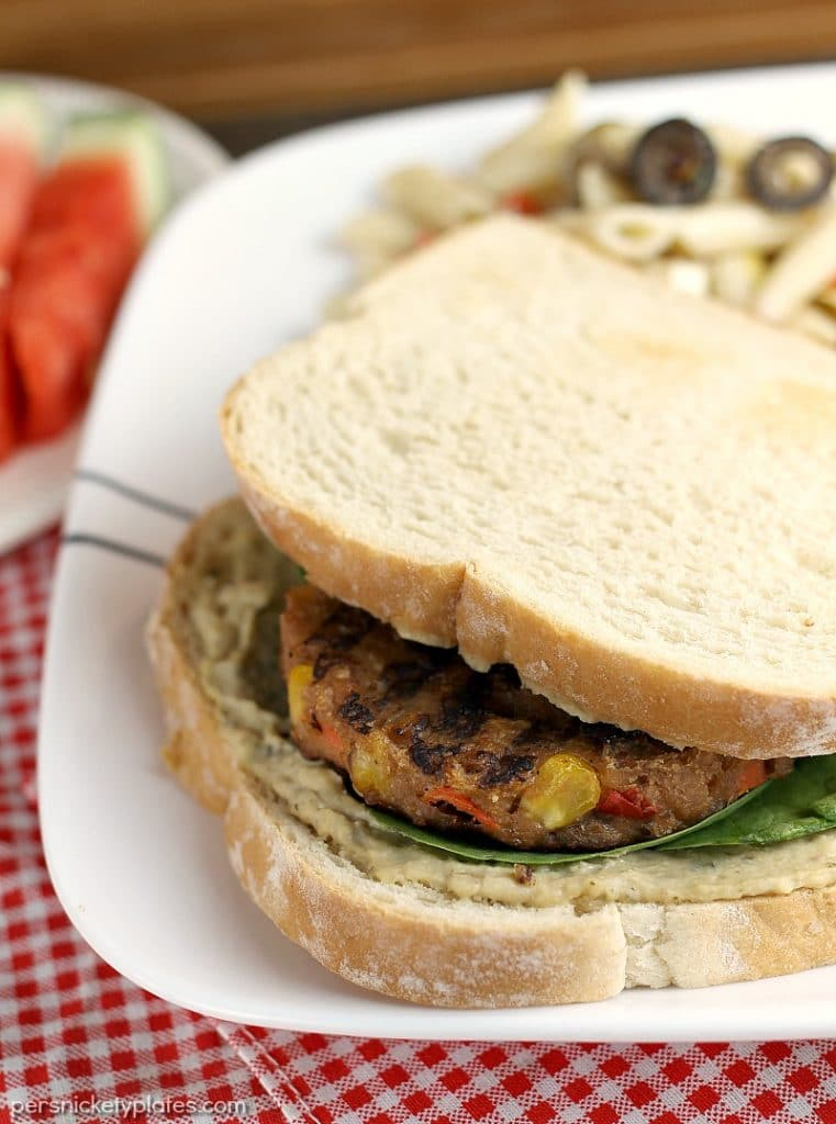 Vegetarians can enjoy barbecues, too! This Veggie Burger with Spinach and Hummus is the perfect alternative to traditional hamburgers for your next BBQ. | Persnickety Plates