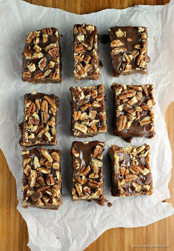 Salted Chocolate Caramel Bars start with a layer of chocolate shortbread, topped with a thick layer of homemade salted caramel, and finished off with toasted pecans. | Persnickety Plates