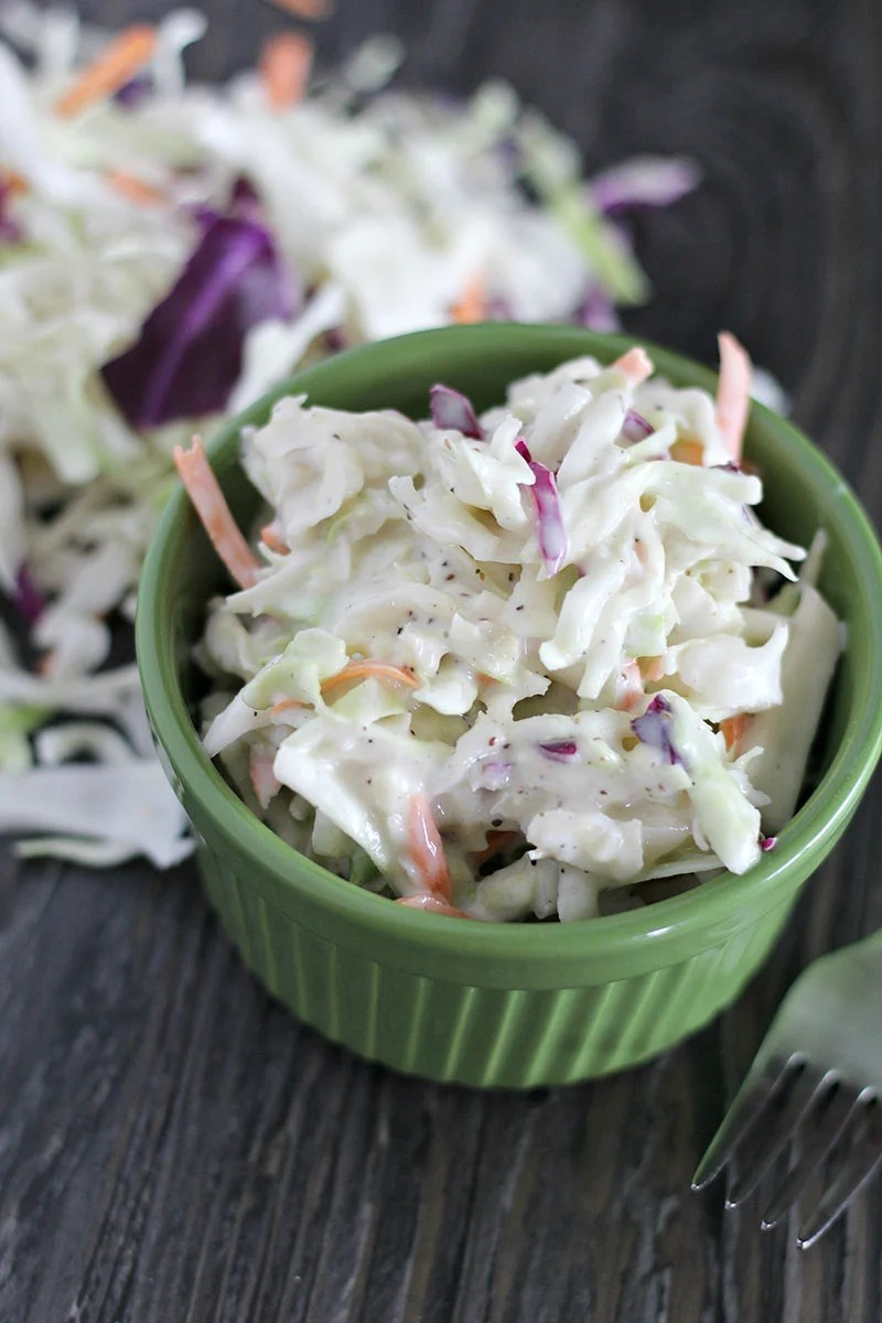 creamy coleslaw in green bowl