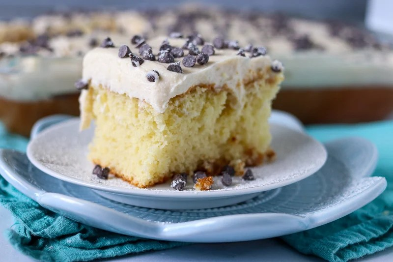 white cake topped with cannoli filling and mini chocolate chips