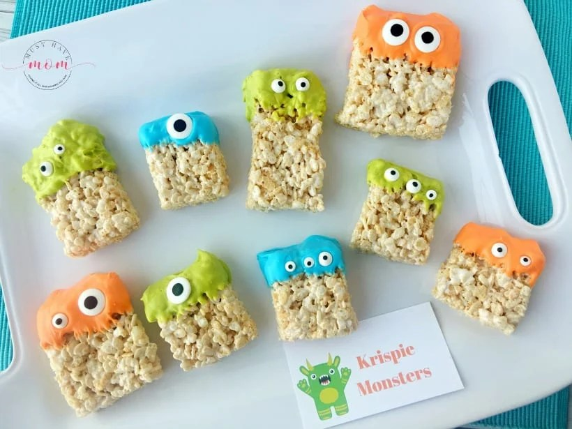 colorful frosting dipped rice krispy treats with monster eyeballs