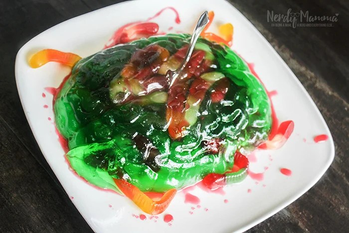 plate full of jell-o in brain shape with gummi worms
