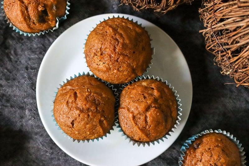 three pumpkin muffins on white plate