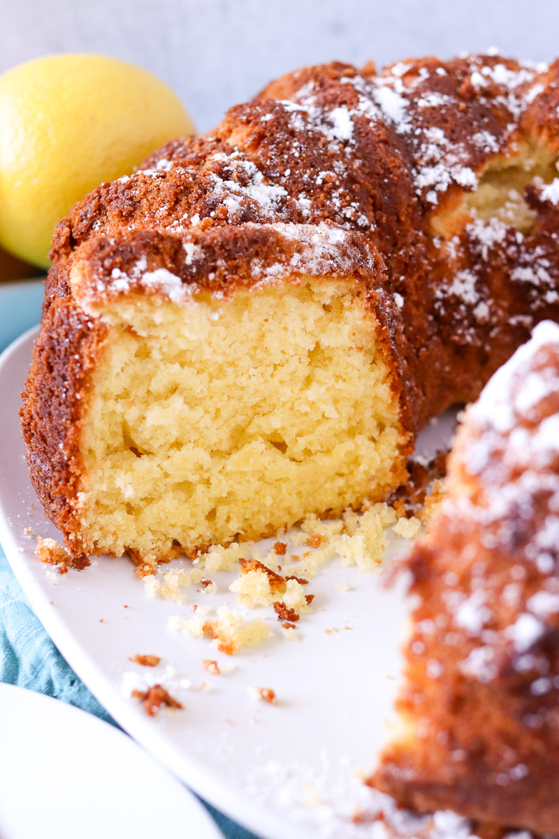 lemon bundt cake with a slice taken out