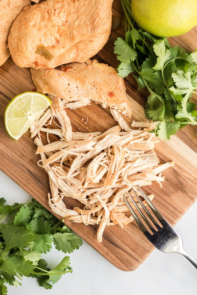 shredded chicken breast on a cutting board