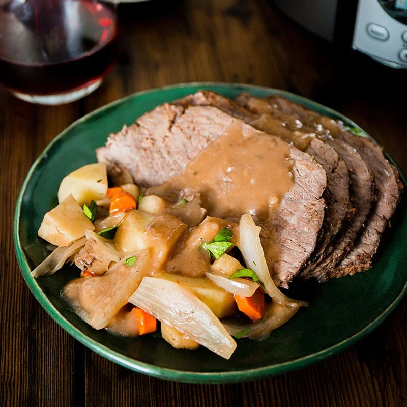 plate of pot roast topped with gravy