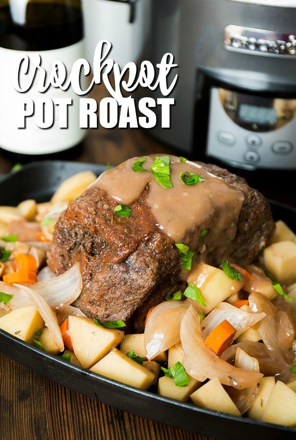 crockpot pot roast surrounded by veggies on a platter