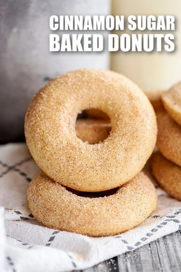 Homemade baked donuts will save you a trip to the donut shop this weekend! Dip the freshly baked donuts in cinnamon and sugar while they're still warm for the perfect treat. | www.persnicketyplates.com
