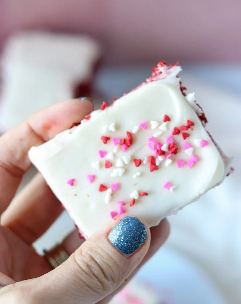hand holding a cookie bar with valentine sprinkles