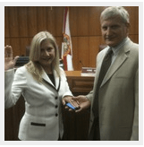 Anne Gerwig being sworn into seat on Wellington village council