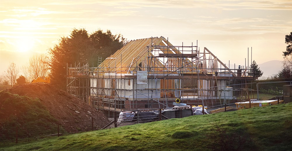 House build. House with roof rafters showing and scaffolding