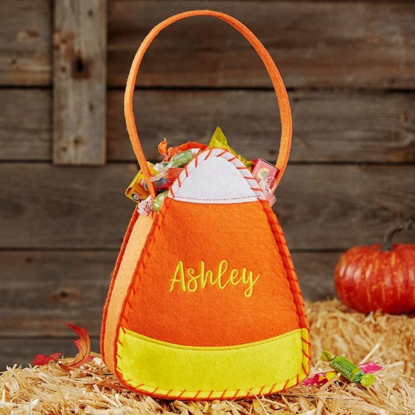 Fold the bag in half with the right sides facing you and match up the color strips. Candy Corn Embroidered Halloween Trick Or Treat Bag