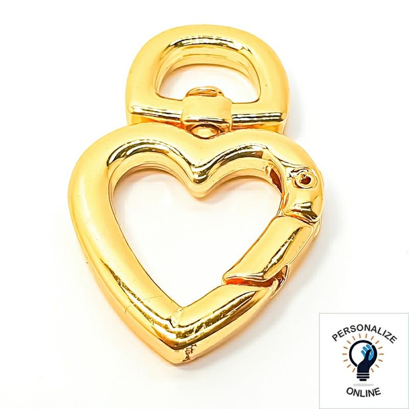 Coração mosquetão dourado
