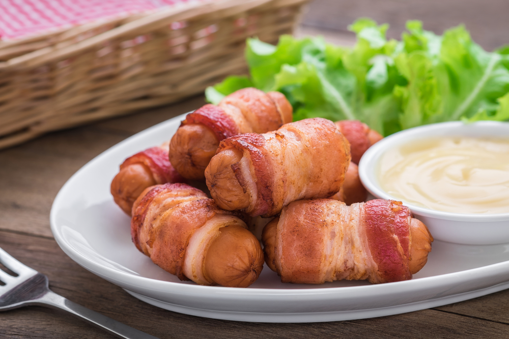 A yummy plate of bacon-wrapped smokies is a fun fat-burning snack. It's the Personal Trainer Food way!