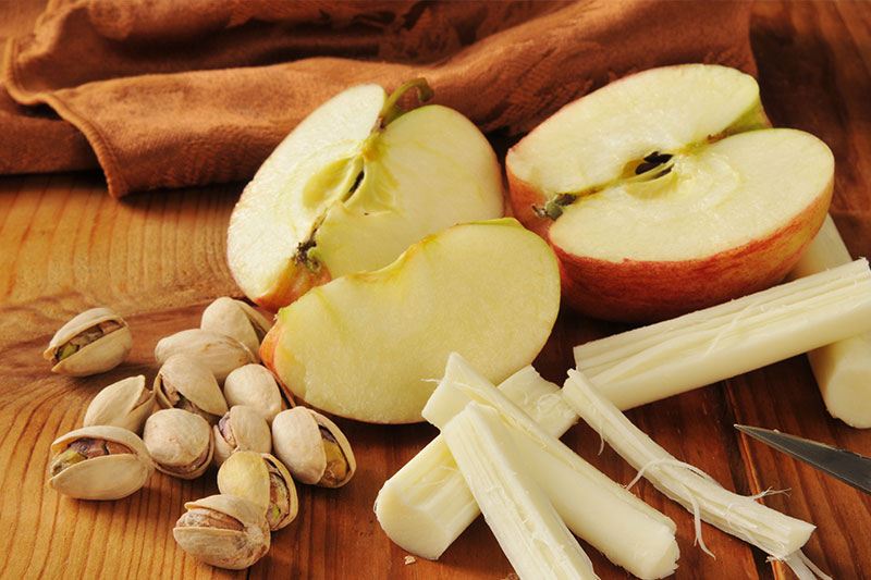 Choose snacks like apples, cheeses, and nuts during the day to lose weight without starving yourself.