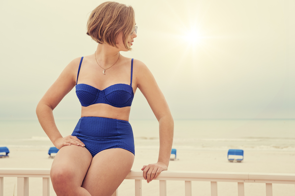 Take a cue from your favorite pin-up with a high waist and corset top; wear this flattering body-positive swimsuit trend with confidence.