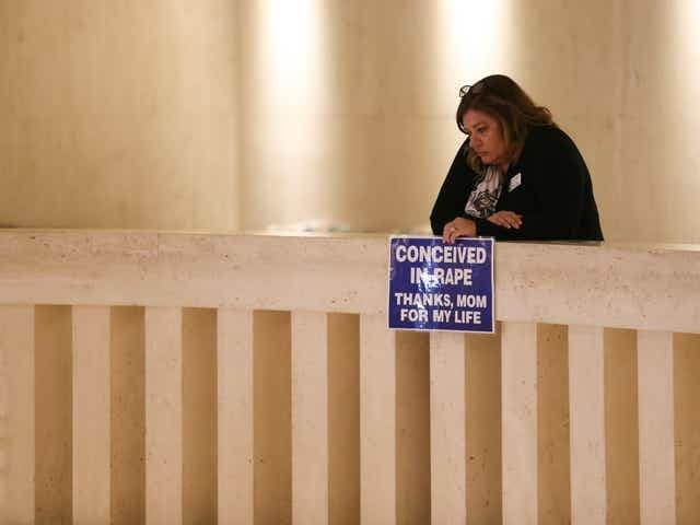 Pam Stenzel Holds Conceived in Rape Sign