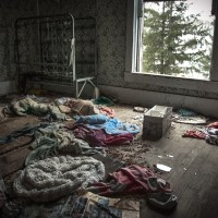 What We Forgot - Children's clothes left abandoned in their room.