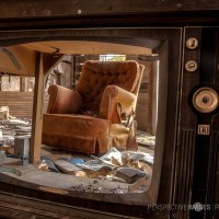 Please Change the Channel - A view through a broken television set.