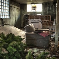 Nuclear Christmas - Christmas tree, furniture and personal belongings abandoned in the basement of a house at a Colorado ghost town