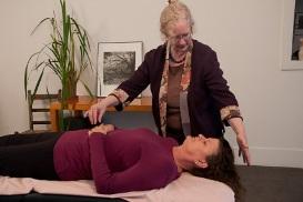 Laurie performing acupressure