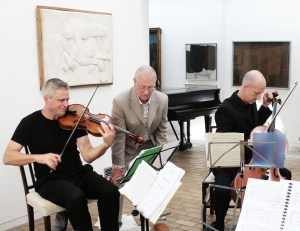 The composer, hard at work with his team. With Neil Heyde and Morgan Goff. Kettles Yard My 2014 (Photo  Malene Skaerved)