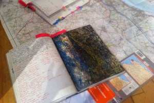 Peter Sheppard Skaerved's notebooks, drawings and maps laid out at a workshop for students at Dover Museum. Summer 2015