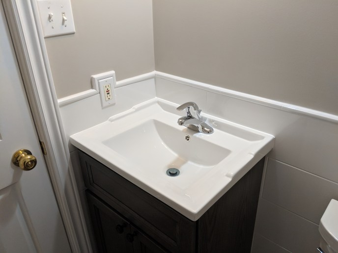 Small bathroom reno, tiles, tile trim, and vanity installed