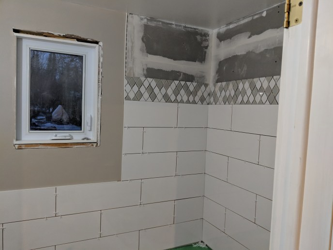 Small bathroom reno, tiles being installed