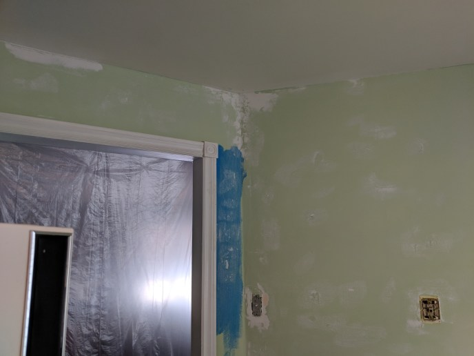 Kitchen wall with mud on it, before painting